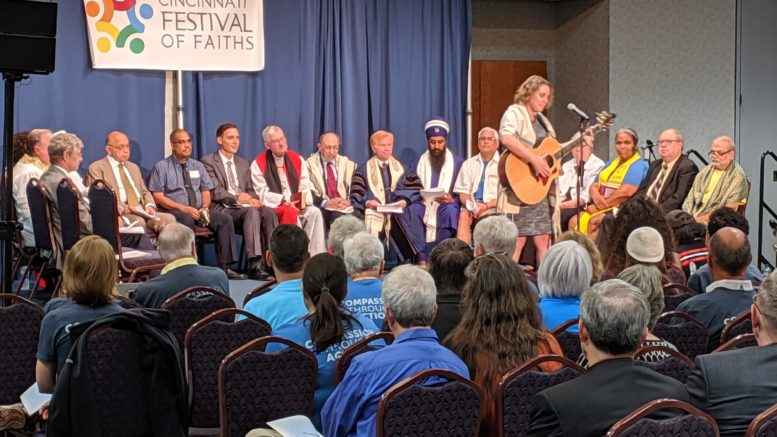 Women playing guitar at Cincinnati Festival of Faiths